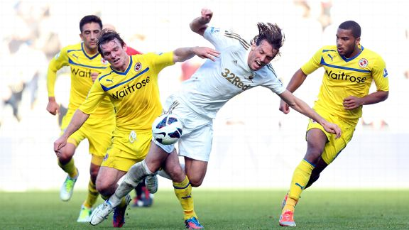 Reading's Jay Tabb tackles Swansea's Michu