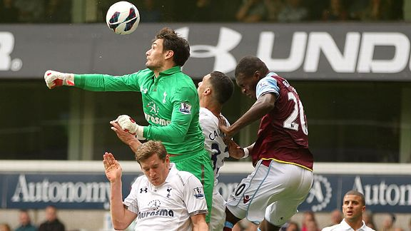 Hugo Lloris punches clear on his Premier League debut