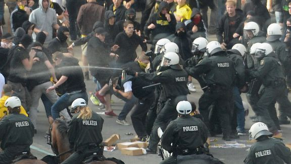 Fans of Dortmund clash with riot police