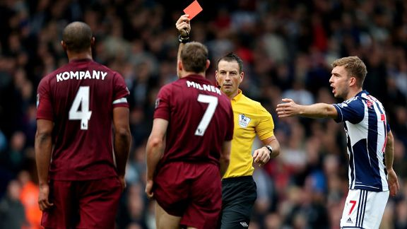 Man City's James Milner was sent off for a foul as the last defender