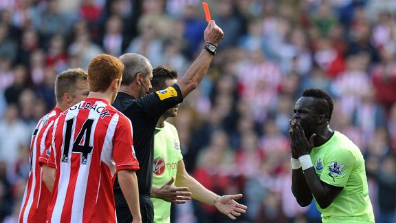 Chiek Tiote is shown the red card for Newcastle in the Wear-Tyne derby
