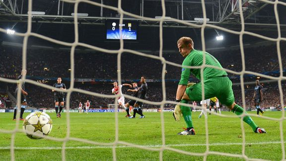 Joe Hart looks on as Siem de Jong's effort finds the back of the net