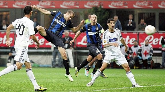 Rodrigo Palacio heads home Inter's late, late winner against Partizan Belgrade