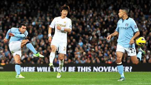 Carlos Tevez scores his fine winner against Swansea