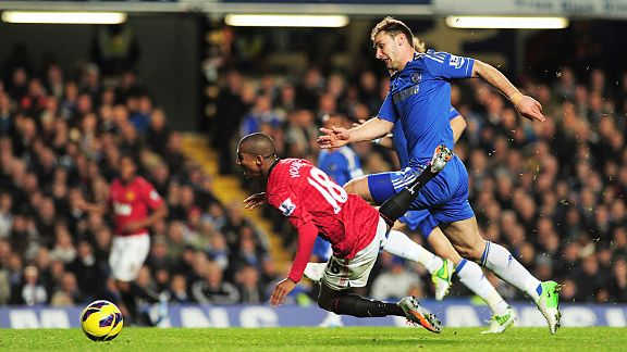 Ashley Young is tripped by Branislav Ivanovic when through on goal, leading to the Chelsea player's red card