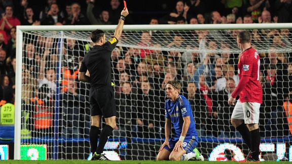 Referee Mark Clattenburg gives Fernando Torres his marching orders