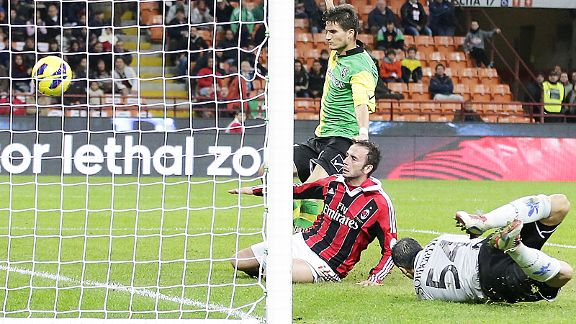 Giampaolo Pazzini slides in to complete the scoring in Milan's 5-1 rout of Chievo