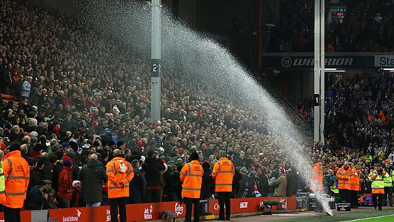 Liverpool fans are accidently soaked at half-time when a sprinkler went off