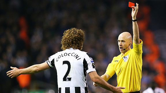 Fabricio Coloccini is dismissed by referee Anthony Taylor for his challenge on Luis Suarez