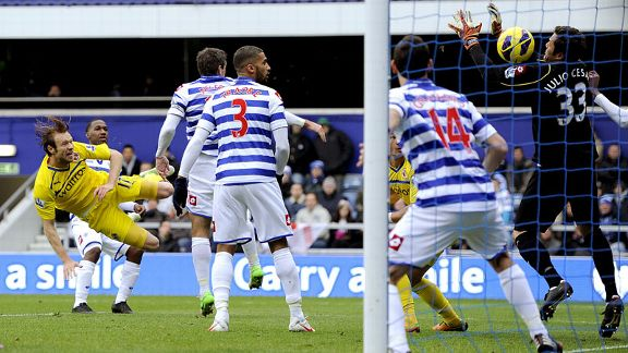 Kaspars Gorkss volleys Reading into the lead at Loftus Road
