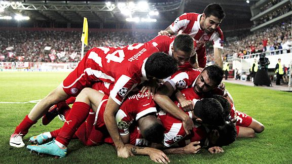 Olympiakos celebrate after Leandro Greco scored their second goal in a crucial 3-1 win over Montpellier