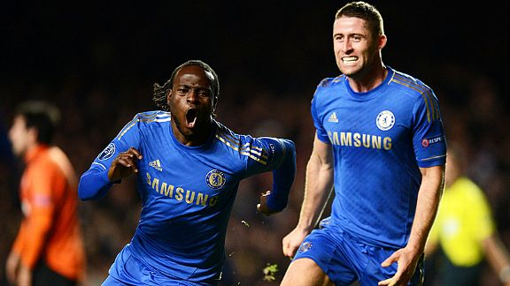 Victor Moses celebrates with Gary Cahill after scoring Chelsea's late, late winner against Shakhtar