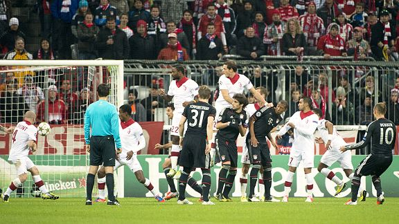 Lille's Florent Balmont deflects Arjen Robben's free-kick past his own goalkeeper for Bayern's third