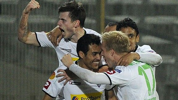 Borussia Monchengladbach's Juan Arango is congratulated on his late equaliser against Marseille
