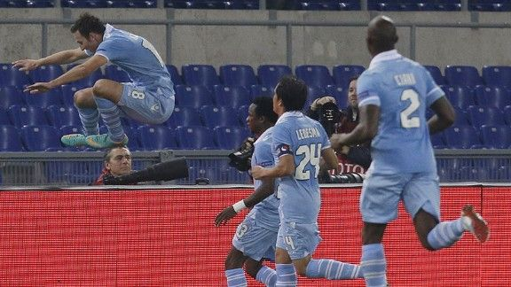 Libor Kozak leaps for joy after scoring for Lazio against Panathinaikos