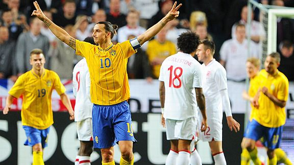 Zlatan Ibrahimovic celebrates after completing his hat-trick against England