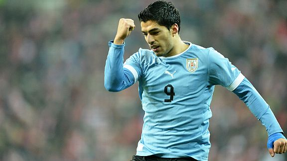 Luis Suarez celebrates after scoring Uruguay's final goal in a 3-1 win over Poland