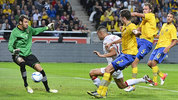 Steven Caulker puts England 2-1 in front against Sweden from Steven Gerrard's free-kick