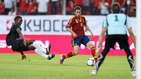 Felipe Baloy leaves the ground to make a tackle on Jordi Alba 