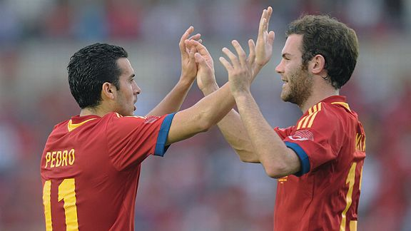 Goalscorer Pedro celebrates one of his goals against Panama with Juan Mata