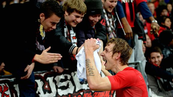 Leverkusen's Stefan Kiessling celebrates with fans after opening the scoring against Schalke