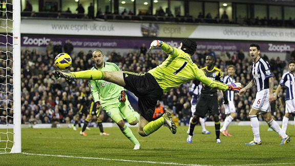 Petr Cech acrobatically tries to keep the ball in play when up for a corner at West Brom