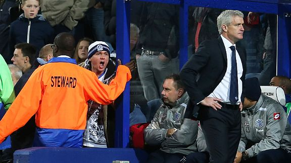A QPR fan shouts at Mark Hughes as the struggling London club slip to a home defeat against Southampton