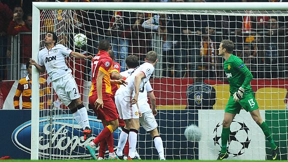 Rafael is unable to stop Burak Yilmaz's header from winning the game for Galatasaray against Manchester United