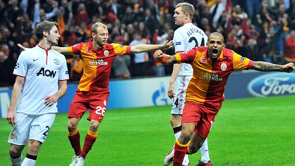 Burak Yilmaz goes wild after scoring Galatasaray's goal against Manchester United