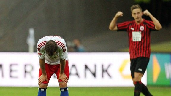 Rafael van der Vaart shows his frustration as Frankfurt's Bastian Oczipka celebrates victory