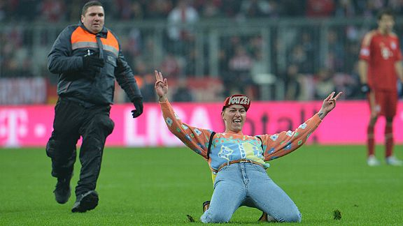 A fan gets a little over-exciting during the crucial Dortmund versus Bayern Bundesliga clash