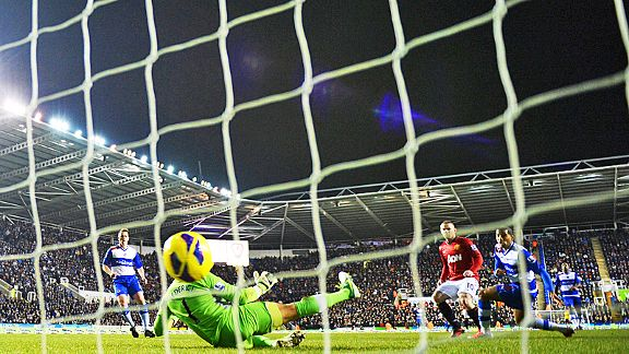 Wayne Rooney scores his second goal of the game for Manchester United at Reading