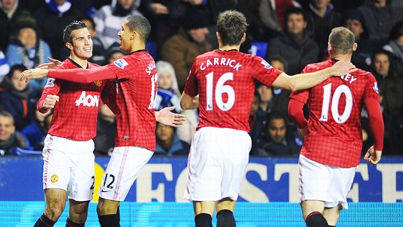 Man United celebrate after Robin Van Persie put them 4-3 up at Reading