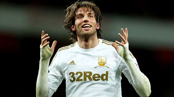 Double-goal hero Michu celebrates against Arsenal