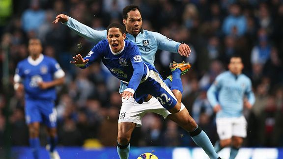 Joleon Lescott sends Steven Pienaar flying through the air