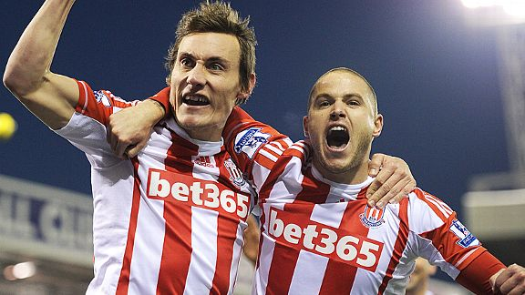 Dean Whitehead celebrates with Michael Kightly after scoring the winner at Stoke
