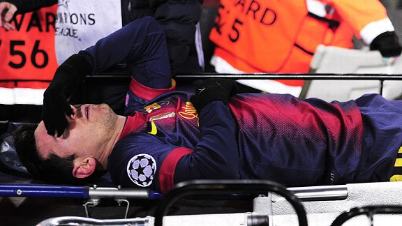 Lionel Messi is stretchered off against Benfica