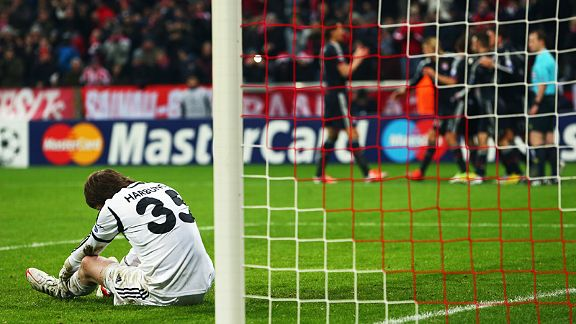 BATE goalkeeper Andrey Gorbunov is crestfallen after Thomas Muller scored Bayern's second goal