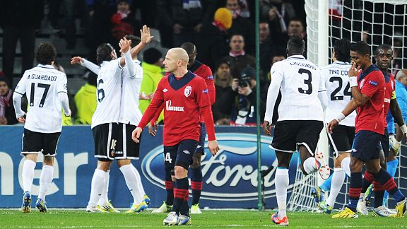 Valencia celebrate after Jonas scored the only goal of the game at Lille