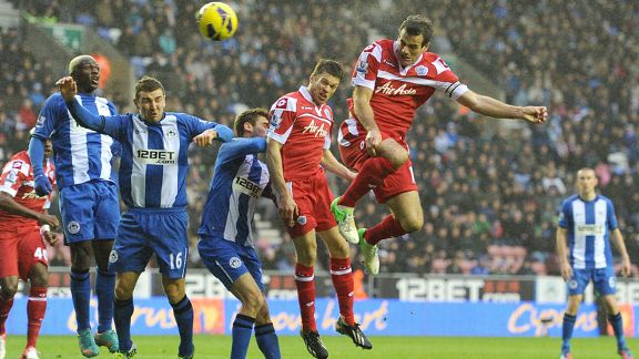 Ryan Nelsen heads home an equaliser for Queens Park Rangers