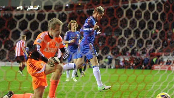 Fernando Torres celebrates netting a penalty to put Chelsea 2-0 ahead