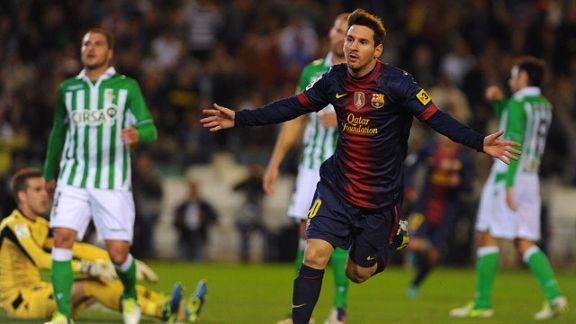 Lionel Messi celebrates after netting the opening goal at Real Betis, equalling Gerd Muller's record of 85 goals in a calendar year
