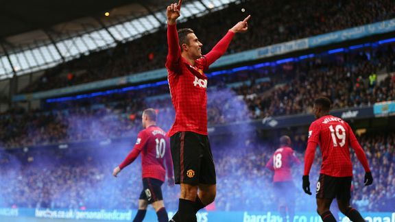 A jubilant Robin van Persie celebrates his derby-winning goal
