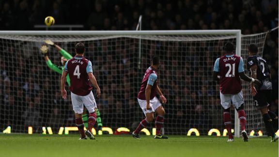 Glen Johnson watches on as his strike gives Liverpool the lead against West Ham