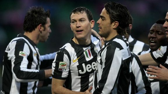 Stephan Lichtsteiner is congratulated by his team-mates after netting the winner for Juventus