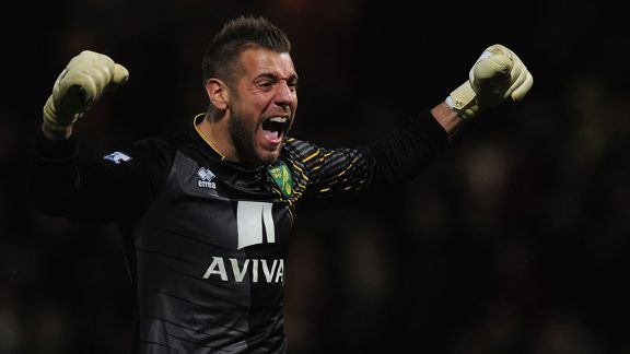 Mark Bunn celebrates Norwich extending their unbeaten Premier League run