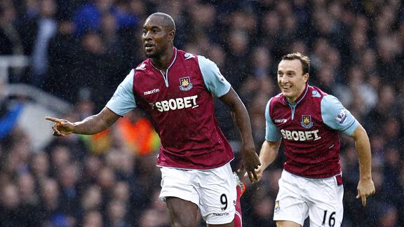 Carlton Cole celebrates after breaking the deadlock against Everton