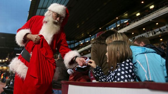 Santa hands out presents to supporters at Upton Park
