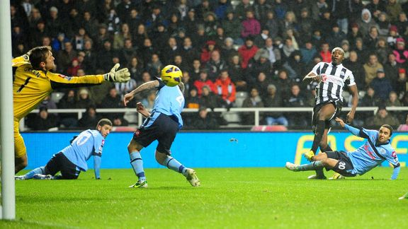 Shola Ameobi fires Newcastle into the lead against QPR