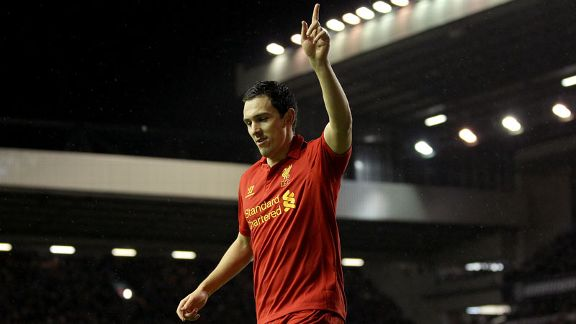 Stewart Downing celebrates after netting his first Premier League goal for Liverpool